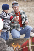 Father and Son Making S'mores on Campfire