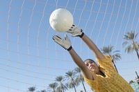 Girl Reaching for Soccer Ball