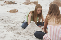 Two Girls Playing on Beach