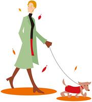 イヌを散歩させる女性