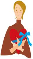 ハート型のプレゼントを抱えた女性