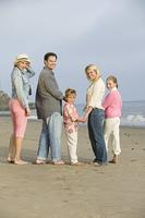 Family standing on beach, portrait