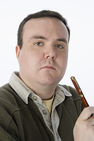 Portrait of mid-adult man holding pen