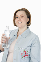 Mature woman holding bottle of water, half-length portrait