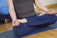 Woman in Lotus Posture in Yoga Class
