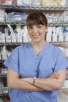 Female nurse in hospital room, portrait