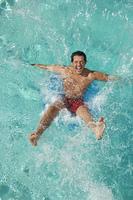 Man falling into swimming pool
