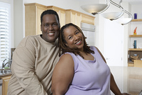 Couple in kitchen, portrait