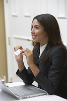 Business woman offering name tag in office