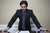 Business man standing at desk in office