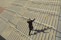 Businessman shouting on stairs, elevated view