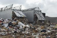 Trucks dumping waste at landfill site