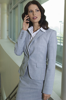 Business woman using mobile phone indoors