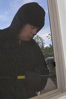 Burglar breaking into house