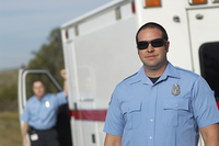 Portrait of paramedic in front of ambulance