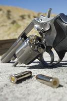 Bullets beside gun, close-up