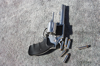 Hand gun and bullets on carpet
