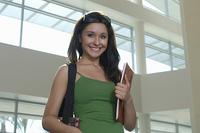 Female student smiling, indoors, portrait