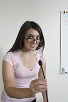 Female student using microphone indoors