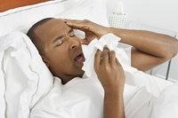 Man with flu in hospital bed