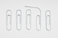 Row of paper clips with one bent