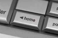 Silver computer keyboard, close-up of Home key