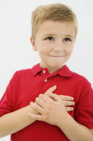 Boy with Hand Over Heart