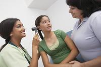 Girl having medical examination at doctors