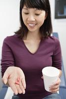 Woman taking medication in hospital