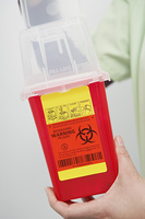 Doctor holding medical container in hospital,close-up