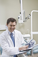 Dentist leafing through medical record
