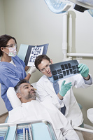 Dentist and patient looking at x-ray