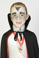 Portrait of boy (7-9) wearing dracula costume for Halloween