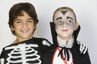 Portrait of boys (7-9) wearing Halloween costumes