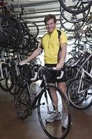 Male cyclist chooses a new bike