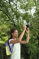 Girl Taking Photographs