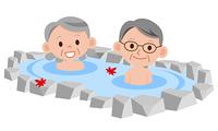 温泉に入るシニア夫婦