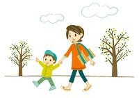 公園で手をつないで散歩する母子