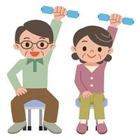 ダンベル体操をするシニア夫婦