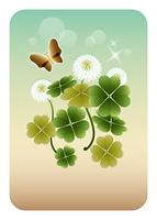 四つ葉のクローバーと蝶