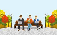 ベンチに座る3人 秋の公園