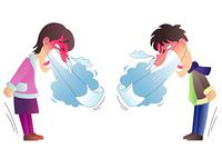 くしゃみをする男の子と女の子