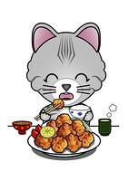 唐揚げを食べる猫