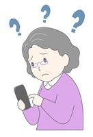 スマートフォンを操作するシニア女性困る