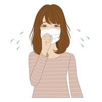 風邪をひいてマスクをしている女性