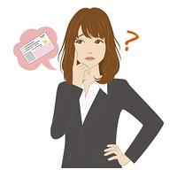 マイナンバーカードと悩む表情の女性