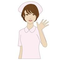 手を振る若い女性看護師