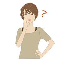 頬に指を当て悩む女性