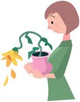 しおれた花を持つ女性