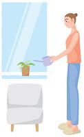 植物に水をやる女性